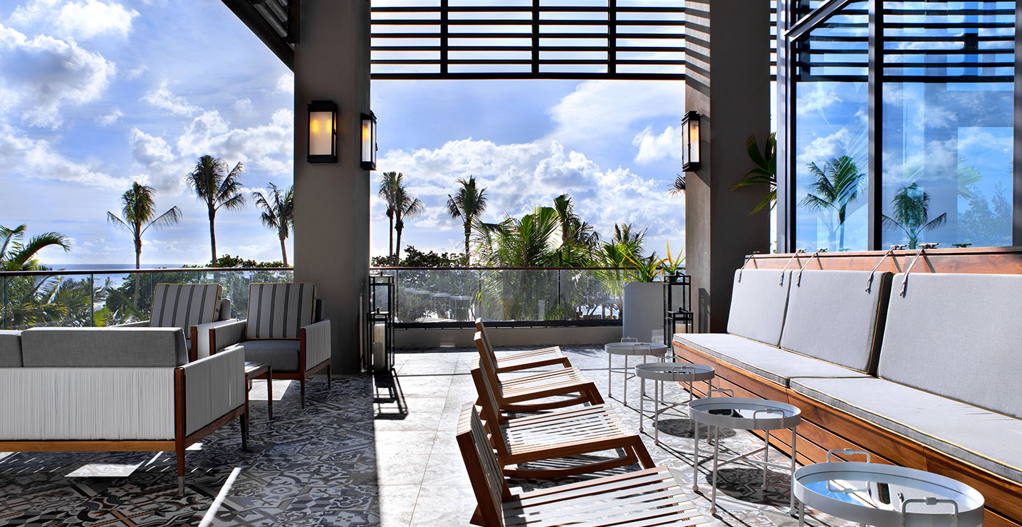 Ave Terrace with multiple table and chairs overlook the Grand Caymans